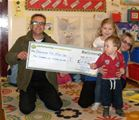 Ranger Pete presents a cheque to Garnock Top Tots (2011)
