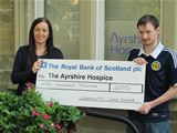 Tony Scott presenting CWL's £200 donation to the Ayrshire Hospice