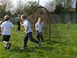 St. Palladius pupils enjoy the willow domes (2011)